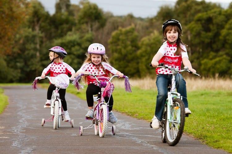 Three Young Girls Cycling