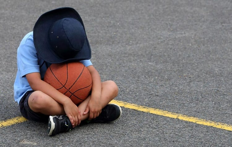 Kid Hugging Basketball