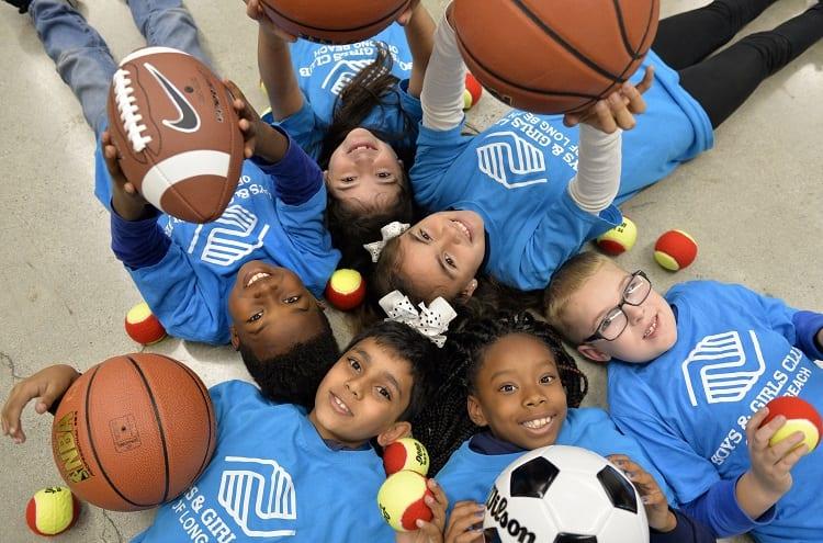 Kids Holding Different Sport Balls