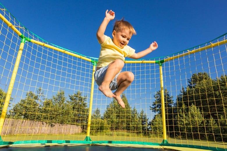 little boy jumping high