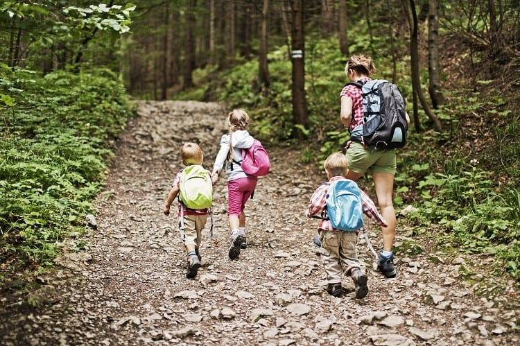 three kids and mom on trail