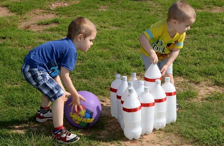 kids playing bottle bowling