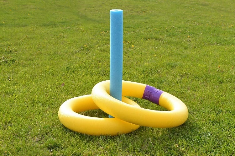 playing pool noodle with ring toss