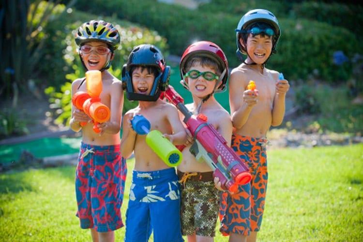 kids playing with water guns