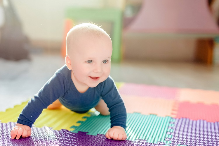 Little Baby Playing On Play Mat