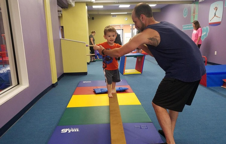 little boy learn to walk on balance bar